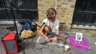 A brief encounter with singer songwriter Sam Garrett + he sings some of his songs in Camden Market.