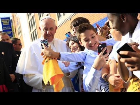 Catholic school children greet Pope Francis in Harlem