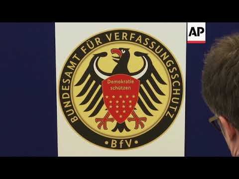 Top German spy loses job after clashing with Merkel over anti-migrant violence