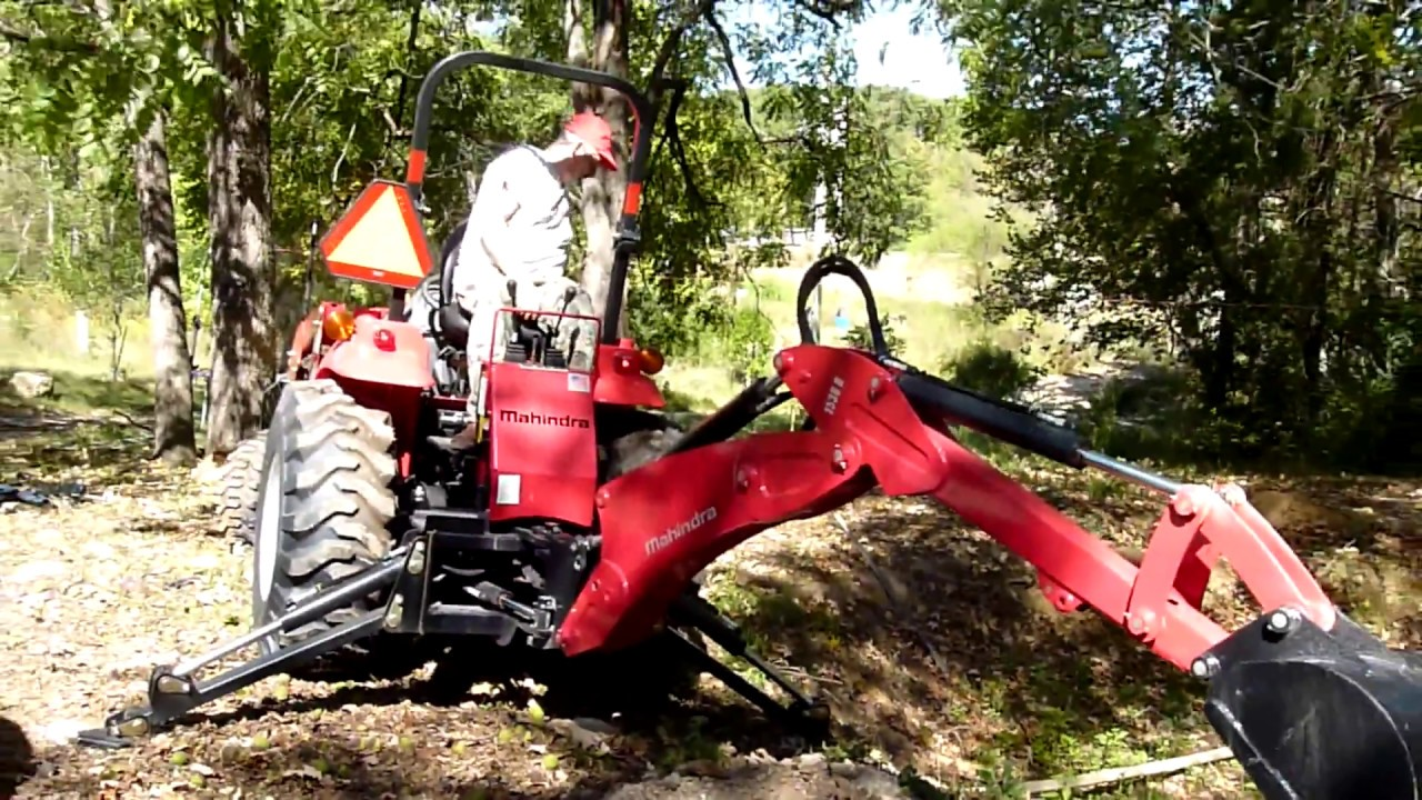 how to work a backhoe