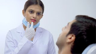 Video of handsome man consulting a female dentist at her clinic