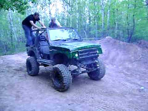 Green Flame Suzuki Samurai doin Wheelies at dresser wi