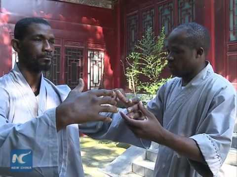 African apprentices learn KungFu at Shaolin Temple