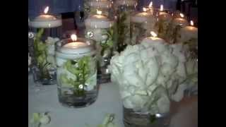 Floating Candle Centerpieces With White Orchids by Sweet 16 Candelabras