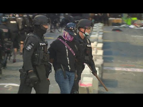 Seattle police push protesters out of CHOP zone