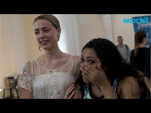 Amber Heard Cries as She and Johnny Depp Hand Out Hearing Aids in Brazil