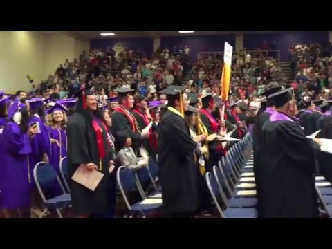 Grads enter to drum music, Haskell Indian Nations University commencement 2016 is underway.