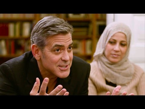 Amal and George Clooney  talk to Syrian families in Berlin