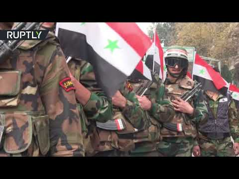 Military parade in Aleppo marks one-year since city's liberation