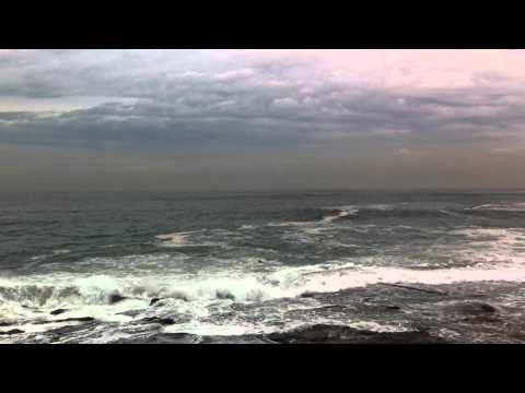 Crazy surfer entering dangerous water via rocks at back of Dee Why - Sydney Australia - 2 May 2011