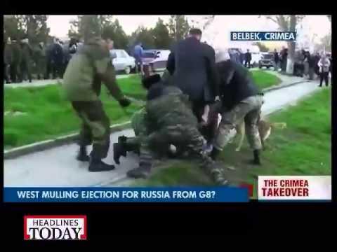 Russian troops take over Ukrainian air base in Crimea