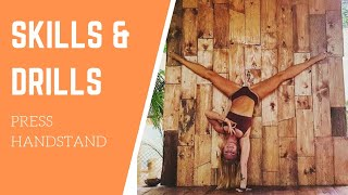 Some very effective and challenging drills to help you nail your Press Handstand!