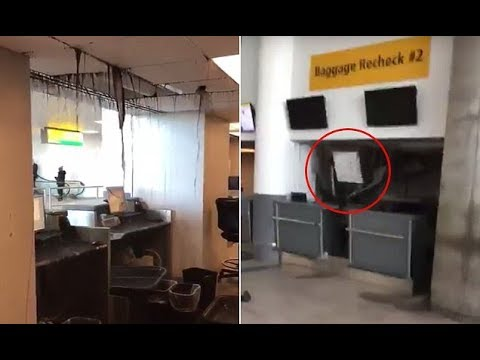 Moment ceiling collapses over JFK airport staff desk