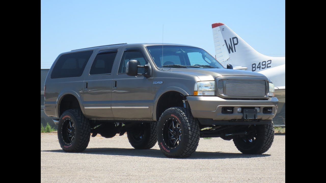 For sale 2004 ford excursion limited diesel 4x4 lifted one of a kind
