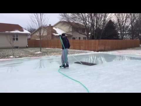 Homemade handheld rink rake zamboni style on our backyard ...