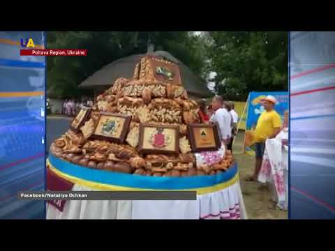 Bakers Bring Giant Traditional Bread to Cultural Festival