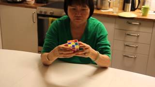 My mom solves a Rubik's cube in 2 minutes 32 seconds!