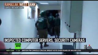 'Intimidation & force': Israeli troops raid Palestinian news agency looking for footage