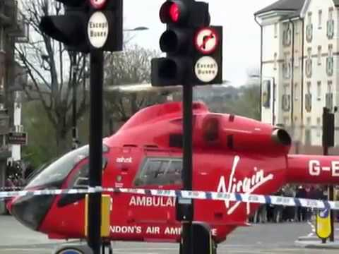 Ambulance Helicopter Pilot Lands In The Street To Pick Up Accident Victims