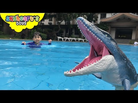 MOSASAURUS in our swimming pool! Skyheart protects ducks from dinosaurs for kids trex toys
