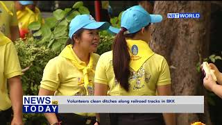 Volunteers clean ditches along railroad tracks in BKK