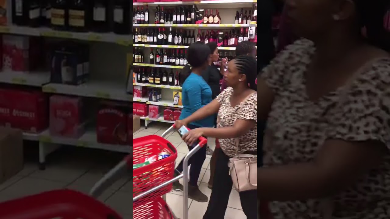 Woman downs bottle of wine while in store