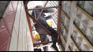 Firefighters Save Old Man Fallen from Balcony