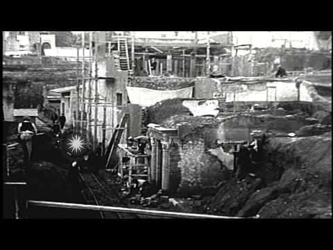 An archaeological project shows workers excavating Herculaneum city in Italy to r...HD Stock Footage