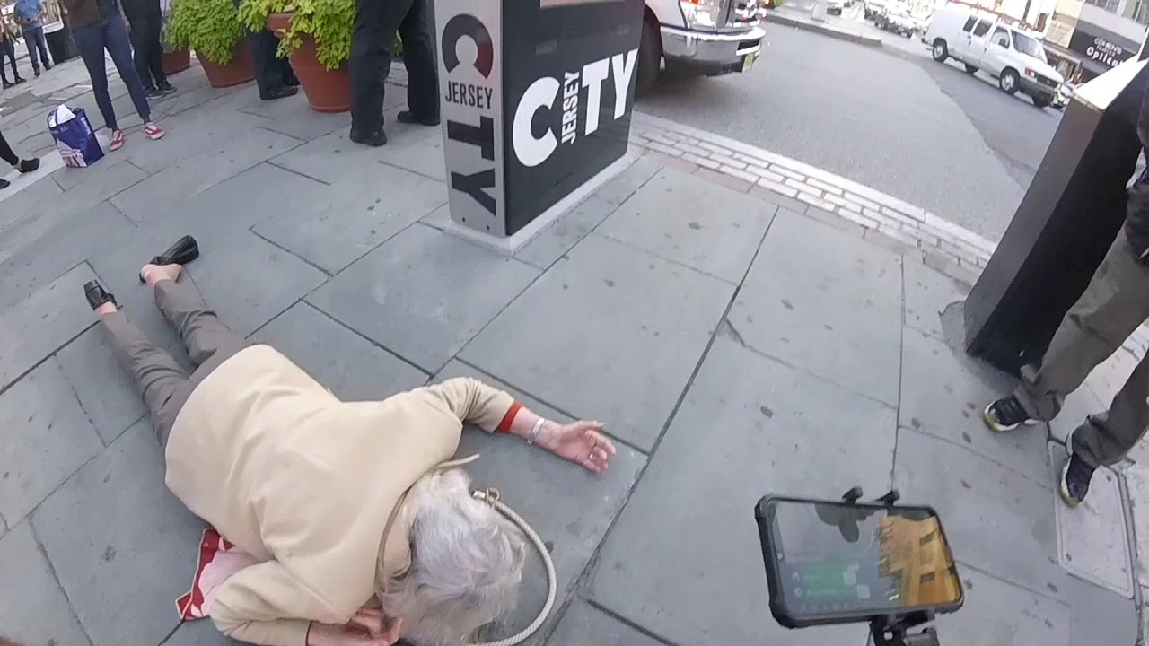 Our Current Reality: Woman Falls While Listening To The Gospel