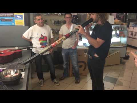 Aaron plays Didgeridoo at music store Florence Italy