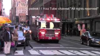 Fire trucks responding FDNY : new Engine 1 & Ladder 24 under perfect Police Officer protection ©