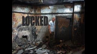 Locked safe room entered in historic British building