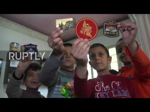 Syria: Russian soldiers deliver humanitarian aid to Aleppo orphanage