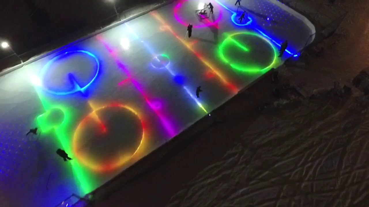 Back yard ice rink LED lights in ice - YouTube