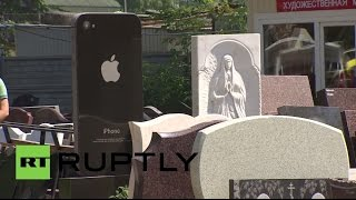 Russia: iGravestone? iPhone-shaped tombstone keeps business alive