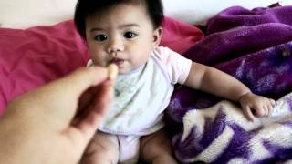 Cute baby eating little puffs and yogurt melts