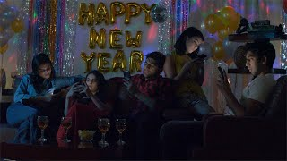 Group of upset young friends using mobile phones in a boring New Year party