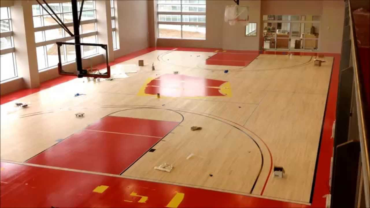 Building the Basketball Court at The American Center - YouTube