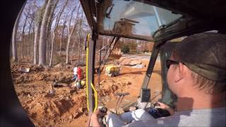 Volvo 300E Excavator Backfilling Pipe