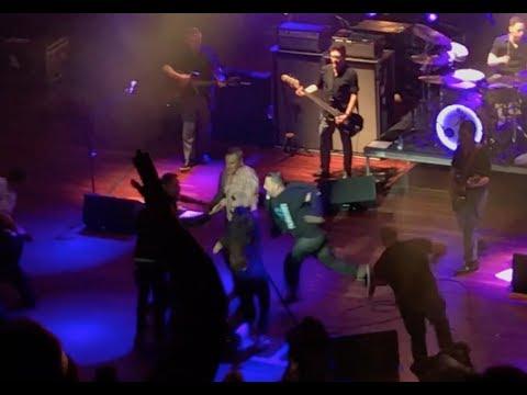 Morrissey fans storm stage ending concert.