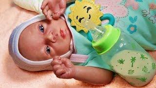 Обложка на видео о Играем в Куклы. Реборн проснулась и кушает. Мы ее переодеваем Зырики ТВ