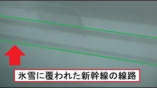 猛吹雪となった岩手県内の東北新幹線上り線の線路軌道を見た東北新幹線下りE5系はやぶさの車窓