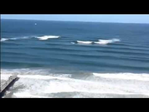 Massive Waves surfed deep off Shore Durban on the Mound
