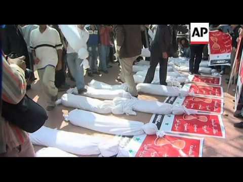 Protesters demand Arab League suspend Syria