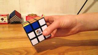 How to solve the 3 by 3 Rubik's cube(with algorithms)