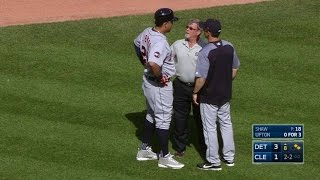 Miguel Cabrera is forced to leave the game after talking to the tra...