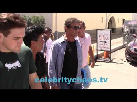 Sylvester Stallone walks with friends in Beverly Hills