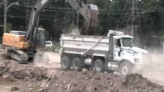 John Deere 350D excavator loading International tri axle dumptruck