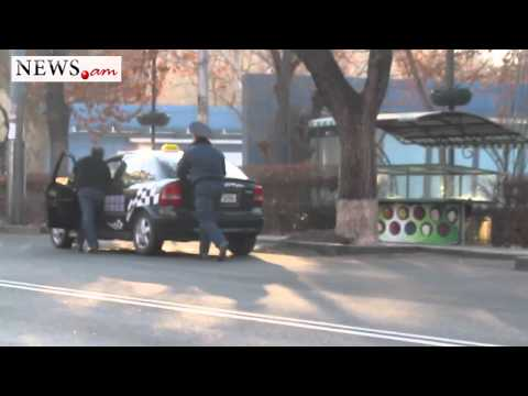 No comment. policeman helps taxi driver in Armenia