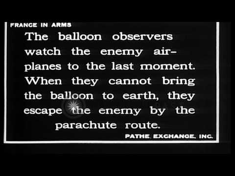 French observer in balloon parachutes to escape approaching German aircraft  (not...HD Stock Footage
